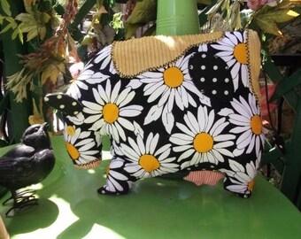 cuddly cow shaped cushion