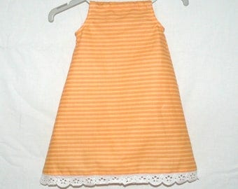 Baby 3 months with orange stripes dress