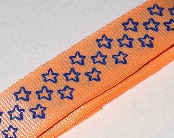 1 meter Ribbon coarse blue stars, neon orange background