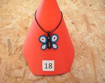 black white blue butterfly pendant