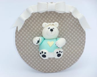 Round frame with a bow and a white Teddy bear polymer clay