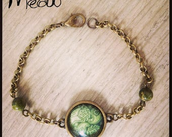 "Bracelet designed by ""Psychedelic"" shades of green"
