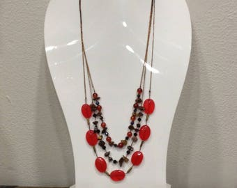 Necklace three rows of red and black natural stones