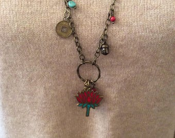 Lotus flower antiqued brass charm necklace.