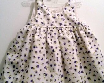 Gathered dress and bloomers with purple flowers