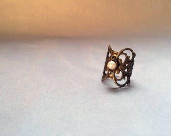 Brass ring with a small Freshwater Pearl