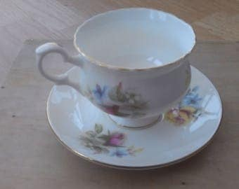 Cup and saucer set by crown staffordshire