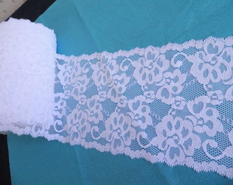 White stretchy Calais lace, iridescent material 1 m 20