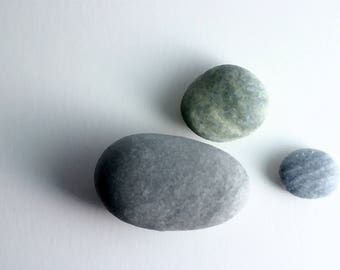 Three pebbles on white ground with digital filter applied A3 jpeg digital download of fine art image
