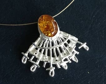 Pendant of silver clay with amber to gold-plated hook
