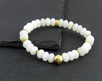 Bracelet made of snow quartz with golden accents