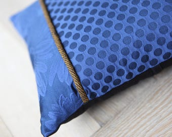 Blue and black square cushion
