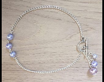 Anklet and purple glass beads