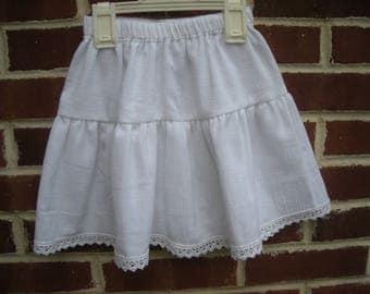 Girl in white cotton seersucker skirt