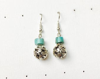 Gemstone (turquoise) and carved beads dangling earrings