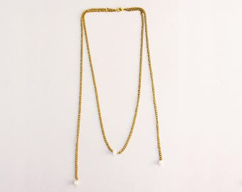 Asymmetrical necklace gold chain on the front back and white beads