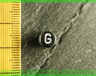 g plastic Pearl round black and white alphabet