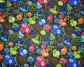 Fabric C619 skulls colored on black coupon 50x50cm