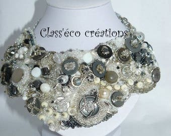 Necklace embroidered with beads and buttons.