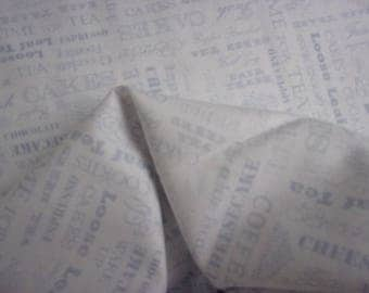 Writing theme patchwork fabric on white kitchen