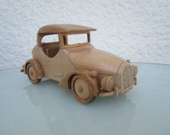 Miniature wood of a kind Convertible car.