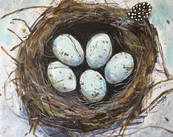 Speckled eggs in nest on canvas