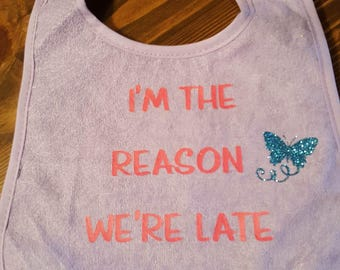 I'm The Reason We're Late baby bib