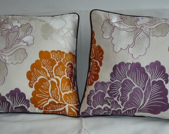Cushions with orange and purple embroidery