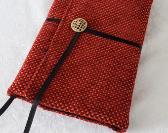 Book adaptable larger, upholstery tacks red and gold, black cotton lining fabric