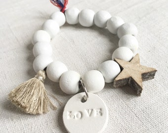 """Bracelet """"Angel"""" white wood and white charms, and beige wood beads"""