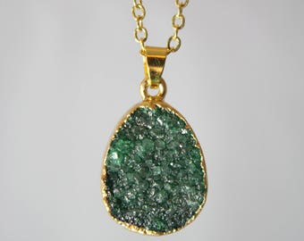 Quartz crystal in green on gold chain necklace