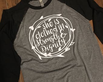 She is Clothed in Strength and Dignity Raglan, Available in Plus Sizes!