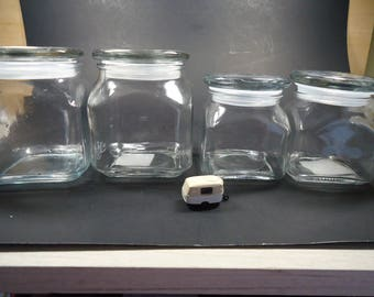 4 Anchor Hocking clear glass containers with lids