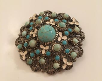 Vintage silver tone brooch with turquoise and white stones