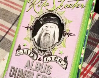 Life and Lies of Albus Dumbledore COVER and pages from the films