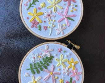 two floral embrodiery decorations