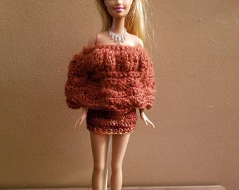 Homemade crochet barbie skirt and bodice top for traditional barbie.  Barbie doll and shoes not included.