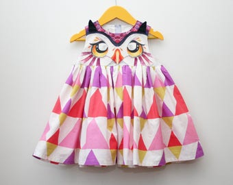 Owl dress for girls, purple and yellow print, triangle pattern, bird portrait watercolor design, eyes on bodice, cute outfit, animal costume