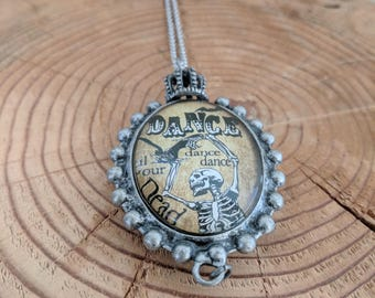 Dancing Decapitated Skeleton Two Sided Pendant Necklace