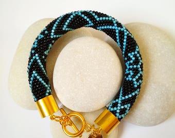 Bracelet with blue ornament
