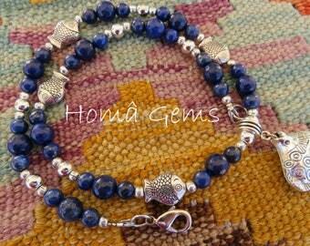 Lapis lazuli, blue, fish charm necklace.