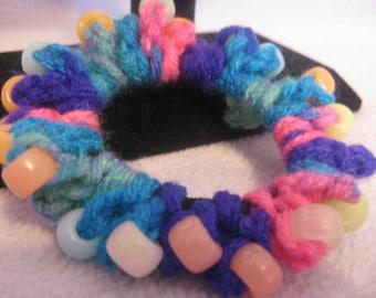 Rainbow crocheted hairband with glow-in-the-dark pony beads