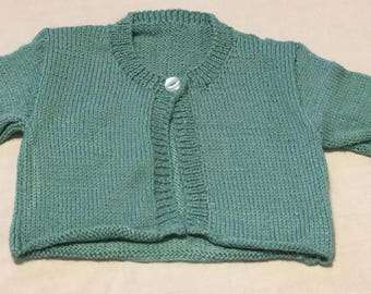 Hand knitted green childs cardigan