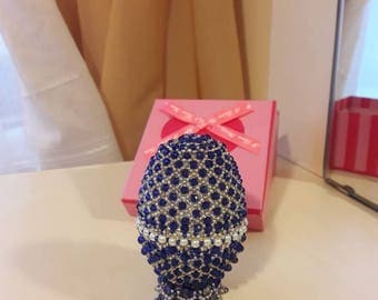 Easter decoration. Egg decorated  with beads and crystals