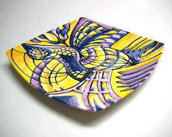 Hand painted ceramic plate in yellows and blues