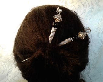 Silver-tone bone hair sticks with sterling silver beads.