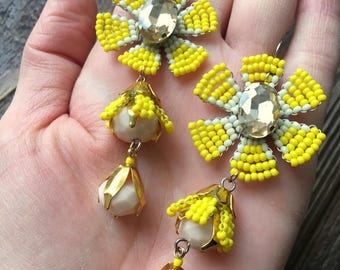 Long earrings of yellow beads with crystals.