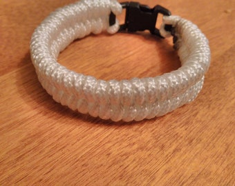 White Fishtail Bracelet With Black Buckle