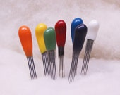 Felt Alive Felting Needles - Quad Point  - Color-coded handles with comfy cushioned grips in a variety of sizes.