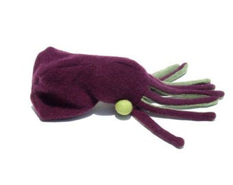 A Purple and Green Octopus with Bright Green Eyeballs